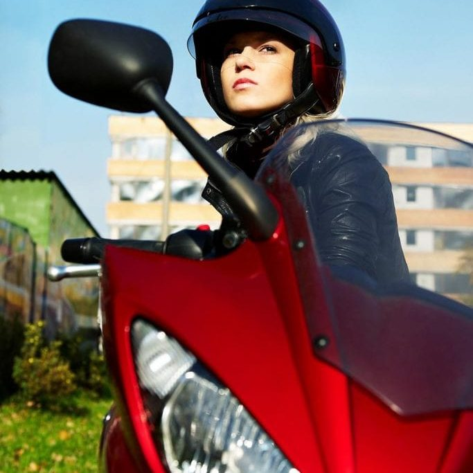 The blonde in a helmet on a red motorcycle